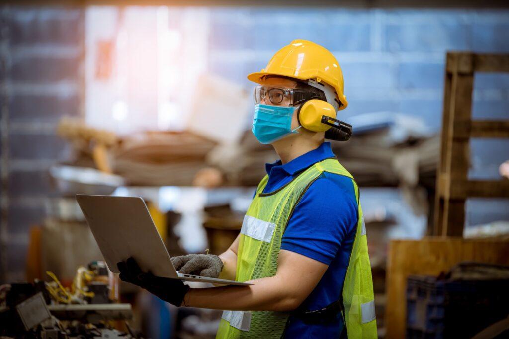 Appraiser appraising factory equipment